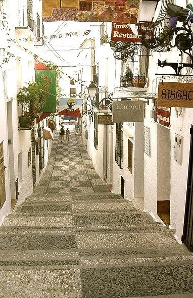 Passageway with restaurants and shops in Altea, Spain